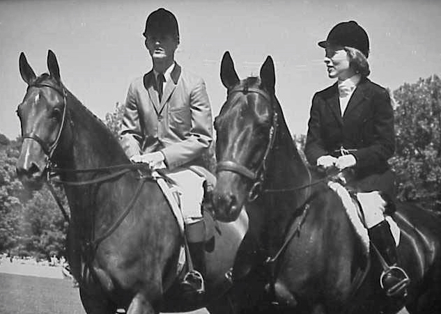Rodney Jenkins on Blue Plum, owned by Bert Firestone, and Betty Reynolds Oare on Navy Commander in the Opening Parade at the Cleveland Grand Prix in 1965