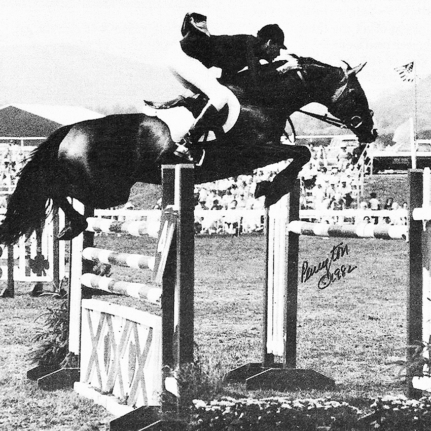 Touch Of Class with Conrad Homfeld riding at Lake Placid where they won the I Love New York Grand Prix in 1982