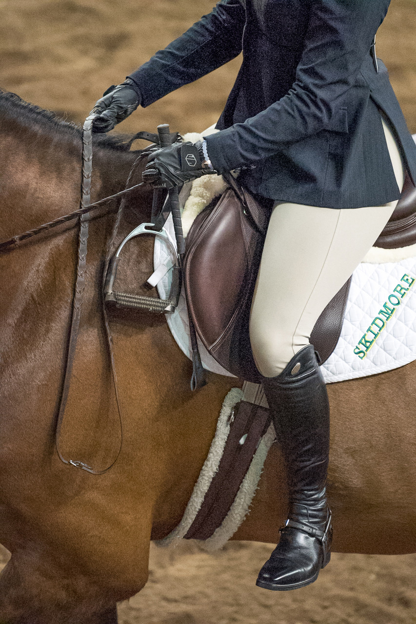 no stirrups crossed over horse's neck
